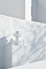 White wall with three crosses