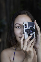 A woman with a camera