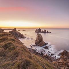 Beautiful rocky coastline at sunset