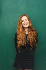 Portrait of red-haired woman smiling at camera