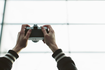 Two arms holding camera up in the air