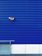 loudspeaker on a blue external wall