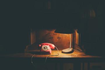 Vintage phone on a wooden desk