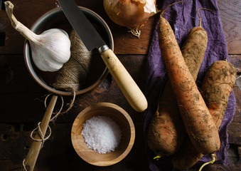 Ingredients for making soup in a rustic setting.