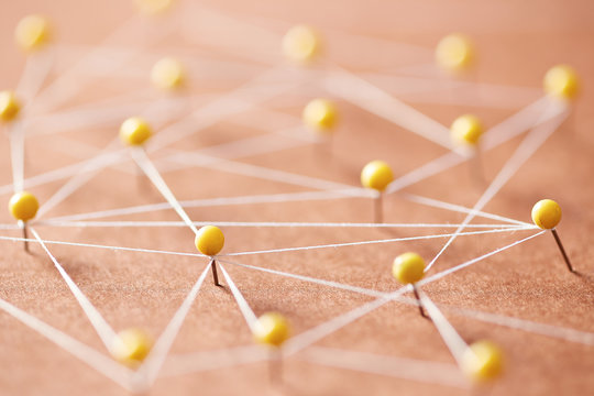 Many yellow pins creating a network
