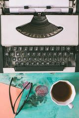 Typewriter and Coffee on the Floral Vintage Table