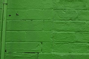 Green Spray Paint on Brick