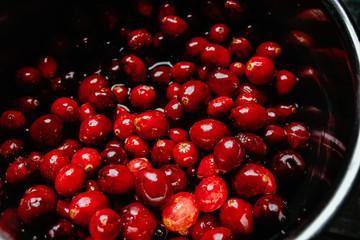 Fresh Ripe Cranberries being prepared in a Saucepan