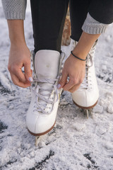 Close-up of woman's hands lacing her skates