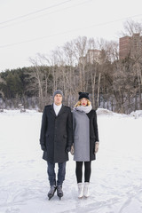 Young couple standing on ice rink