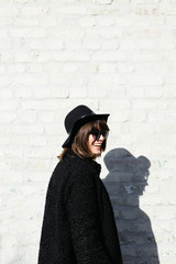 Stylish Woman by the Wall