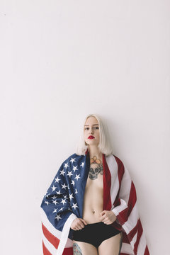 Portrait of woman with American flag against white background