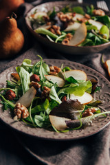 Delicious salad with pear, walnuts and hazelnuts