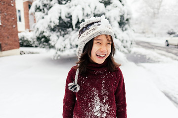 Cute Young Boy Laughing In Snow