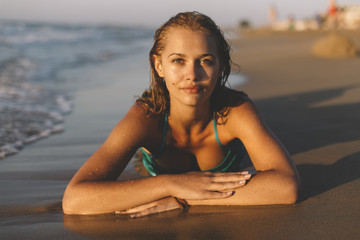 Beautiful young girl posing on the beach.
