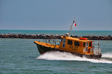 Miami based pilot boat heading out to open ocean to guide a cargo ship through Government Cut to the Port of Miami.