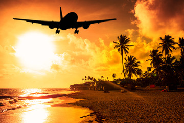 Beach Sunset and airplane lending Wall mural