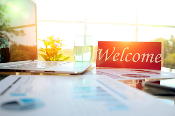 business work place with welcome sign on the table in the office