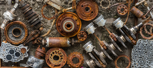 Rusted metallic car parts.