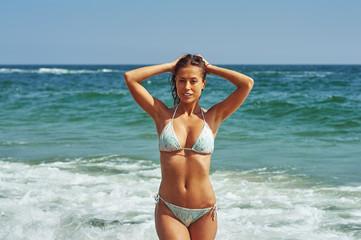 beautiful slender woman in swimsuit at sea. Beach , sea , travelling.