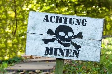 "Warning of mines. Danger of explosion. Line of defense. Military base. German inscription: ""Danger mines""."