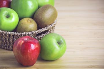 Fresh kiwi, apples on wooden background