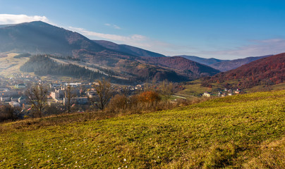 grassy hillside over the village in valley