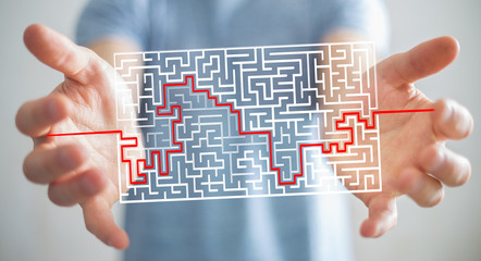 Businessman searching solution of a complicated maze