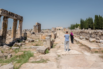 People visit latrine along Frontinus Street at Hierapolis ancient city in Pamukkale, Turkey.
