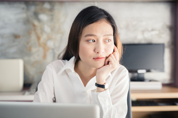 New generation asians business woman using laptop at office
