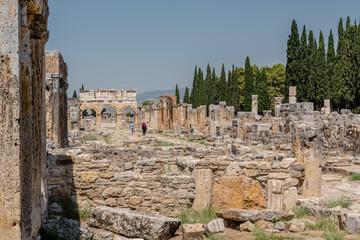 People visit latrine along Frontinus Street at Hierapolis ancient city in Pamukkale, Turkey.