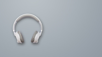 Headphones on gray background. Front view photo. White wireless headphones