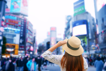 Tourist is sightseeing at Shibuya junction while traveling in Tokyo, Japan.