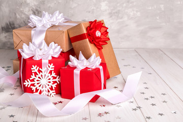 Gift Red Brown Box with Bows of Ribbons White Wooden Background.