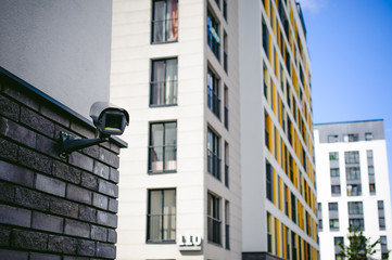 outdoor CCTV camera external video surveillance system. installed on the facade of a residential building