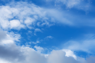 Clouds against the blue sky.