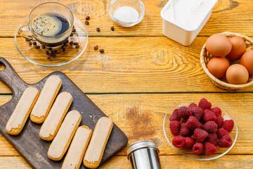Top view of ingredients for tiramisu with raspberries