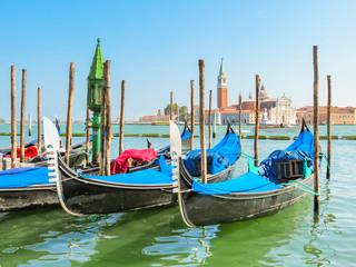 Gondolas moored in the Venetian lagoon