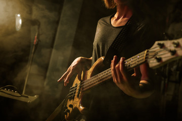 The bass guitar player plays solo.