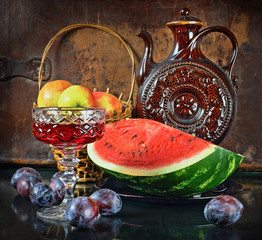 Still life with a jug apples and a water-melon in a retro style