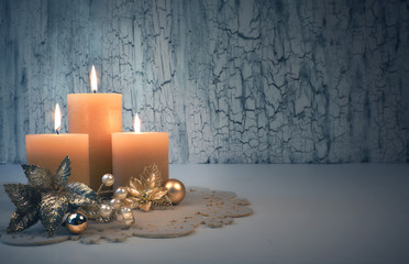 Christmas advent candles with golden decorations