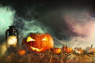 Halloween theme with pumpkins under spider web