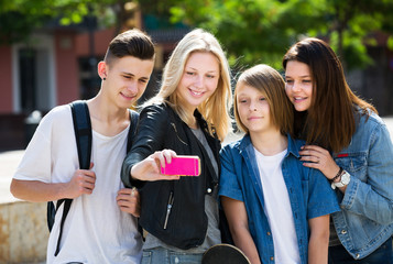 Teenagers taking mobile self picture