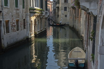 Traditional gondola ride in small canal at residential district of historical buildings and bridge, Venezia, Venice, Italy, Europe