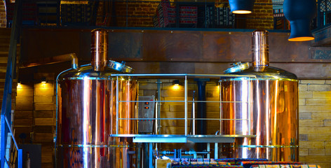 Copper brewing tanks in the brewhous. Equipment for brewing at restaurant, bar, pub. Copper container for brewing.