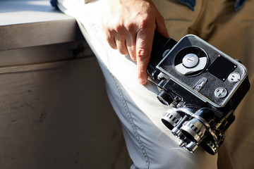 Vintage movie camera with film charged . background concept