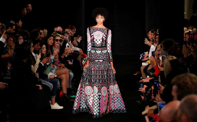 A model presents a creation by Indian designer Manish Arora as part of his Spring/Summer 2018 women's ready-to-wear collection show during Paris Fashion Week