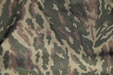 Green and brown military camouflage uniform pattern.