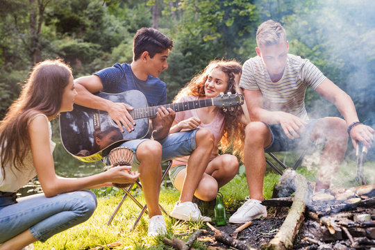 Teenagers camping in forest.