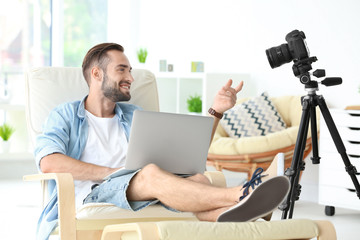 Young blogger recording video at home